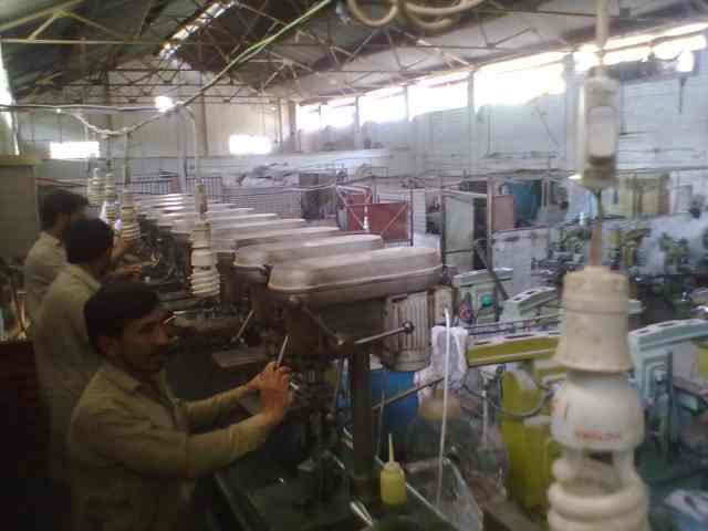 Workers at the factory in Peshawar