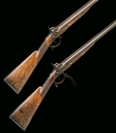 pair of percussion rifles