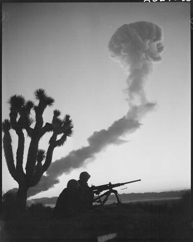 Picture of guns and atomic blasts